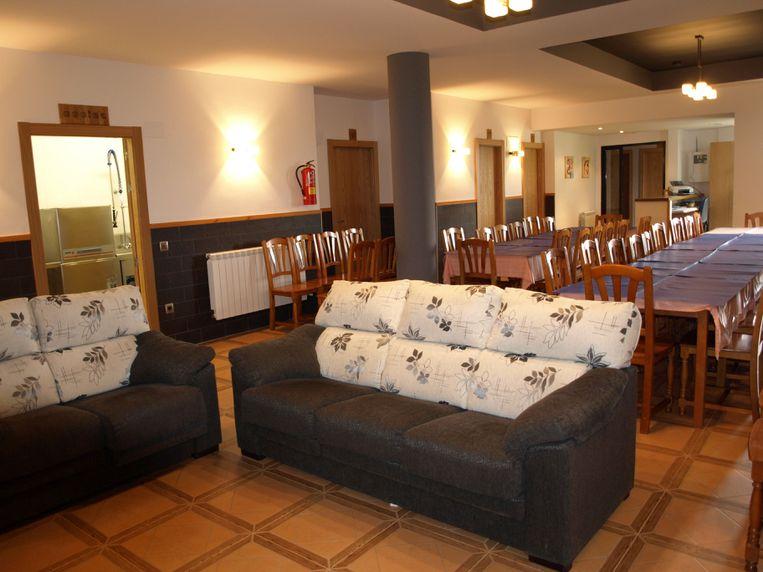 Salón comedor y cocina de la casa rural El Churrón
