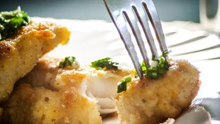 Restaurante con platos de pescados en Tenerife
