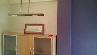 Combinación de pared alisada con colocación de papel pintado